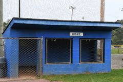 Baseball Dugout. Empty dugout at a baseball field with the home sign on it royalty free stock image