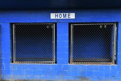 Baseball Dugout. Empty dugout at a baseball field with the home sign on it royalty free stock photo