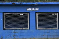 Baseball Dugout. Empty dugout at a baseball field with the visitors sign on it stock image