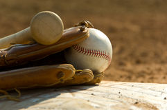 Baseball equipment on base Stock Image