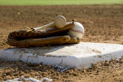 Baseball equipment on base Stock Photography