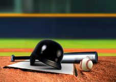 Baseball equipment on base Royalty Free Stock Photo