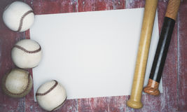 Baseball equipment and empty banner. Top view of baseballs and bats on aged red wood background with banner. Advertisement concept. Mock up, 3D Rendering Stock Image