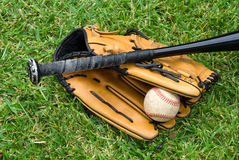 Baseball equipment on grass Royalty Free Stock Photography