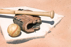 Baseball equipment on home plate Stock Photography
