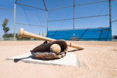 Baseball equipment on home plate Royalty Free Stock Photo