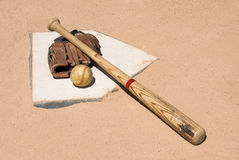 Baseball equipment on home plate Royalty Free Stock Photos