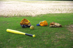Baseball equipment for kids. A baseball glove, a ball, a bat and a cap for kids Royalty Free Stock Photography
