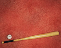 Baseball equipment on red background Royalty Free Stock Photography
