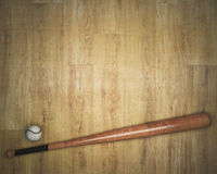 Baseball equipment on wooden background. Top view of baseball and bat on wooden background with copy space. Activity concept. Mock up, 3D Rendering Royalty Free Stock Images
