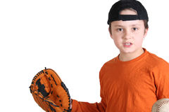 Baseball fan. A cute little boy playing a game of baseball in the summer royalty free stock image