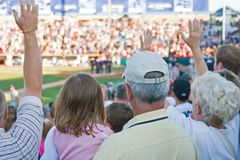 Baseball Fans. Watch for their seats in the stadium as the players play a game Stock Images