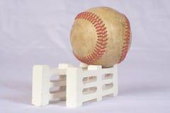 Baseball on fence royalty free stock photo