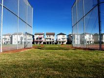 Baseball fence protection. Baseball field - outfield protection - cover over the fence helps outfielders not get injured by the fence top Royalty Free Stock Photography
