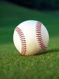 Baseball on the field. Close up of a baseball on the field Royalty Free Stock Photos