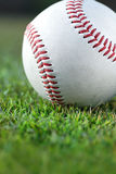Baseball on the field. Close up of a baseball on the grass Stock Photography