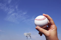 Baseball field and a ball and a blue sky Royalty Free Stock Image