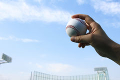 Baseball field and a ball and a blue sky Stock Photography