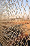 Baseball Field Chainlink Fence. Early morning practice Royalty Free Stock Photos