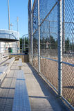 Baseball field fence. Looking out onto the baseball field from the sidelines Stock Photo