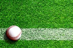 Baseball on Field With Copy Space. Baseball on field with white line marking and copy space. Line represents infield line or foul line royalty free stock image