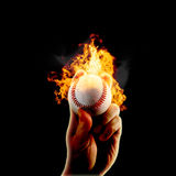 Baseball flames fire hand. Hand grips baseball on fire isolated on black background Stock Photography