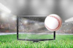 Baseball Flying Out of TV Screen in Stadium Royalty Free Stock Photo