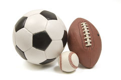 Baseball, Football, and Soccer Ball. A soccer ball, baseball hardball, and a football on a white background Stock Photography