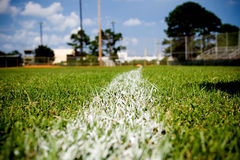 Baseball Foul Line. Closeup of the foul line on a baseball field third base line Royalty Free Stock Image