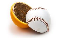 Baseball fruit. Slices of baseball ball and orange on white background Royalty Free Stock Photos