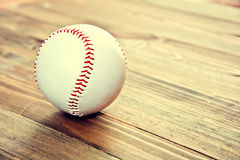 Baseball game. Baseball ball on wooden background. Vintage retro picture Stock Photography