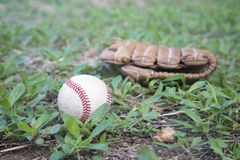 Baseball game. Baseball ball, baseball glove. Stock Photos
