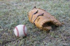 Baseball game. Baseball ball, baseball glove. Royalty Free Stock Images