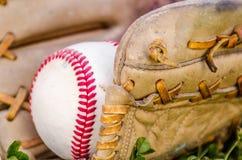 Baseball game mitt and ball Stock Photos