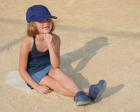 Baseball girl with blue hat Stock Photos