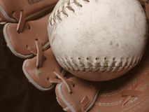 Baseball and glove. On black background Royalty Free Stock Photos
