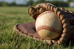 Baseball in a Glove. In the outfield Stock Photo