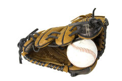 Baseball and glove. Baseball and brown baseball glove isolated against white Royalty Free Stock Images