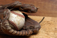 Baseball and Glove. A low contrast image of a well used hardball and glove for those who love the sport of baseball Royalty Free Stock Photos