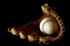 Baseball glove. And ball on a black background Stock Photo