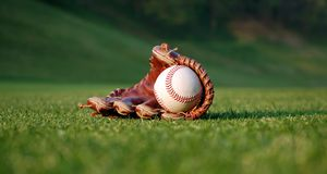 Baseball glove. Close up of a well worn baseball glove on the field royalty free stock photo