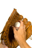 Baseball in glove. Pitcher holding baseball in glove againsy white background Stock Image