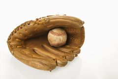 Baseball in glove. Royalty Free Stock Image