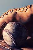 Baseball and glove. Baseball (cross-processed stock image