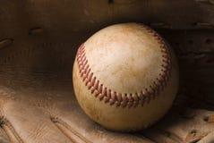 Baseball and Glove. Closeup of a baseball in an old glove Stock Photography