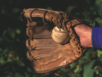 Baseball and glove. A baseball and baseball glove in hand stock photos