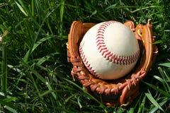 Baseball and Glove. A baseball glove with a baseball Royalty Free Stock Photos