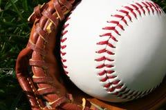 Baseball and Glove. A baseball glove with a baseball Royalty Free Stock Images
