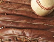 Baseball on glove. A macro of a baseball in glove Royalty Free Stock Image