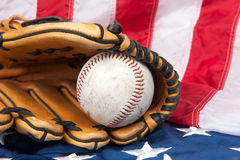 Baseball and glove on American flag Royalty Free Stock Photos